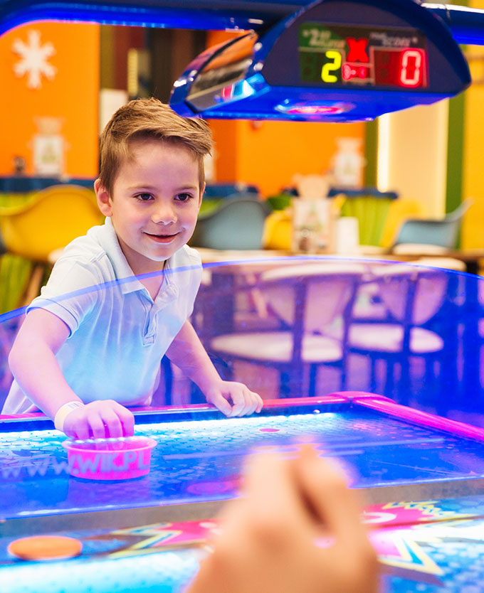 Young Boy Plaing Air Hockey