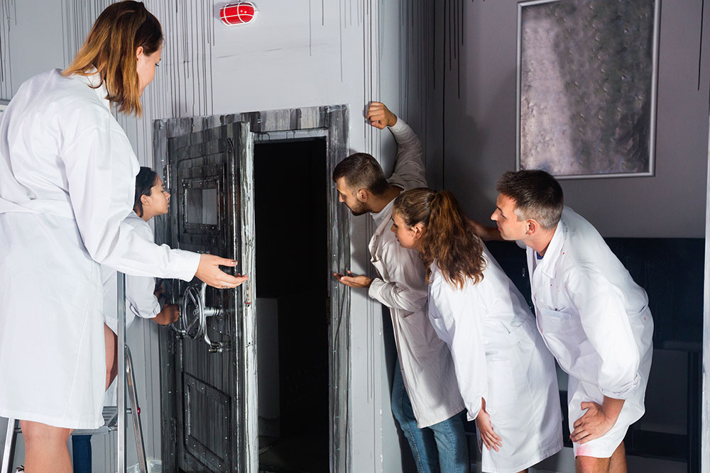 Guests In Lab Coats In Escape Room
